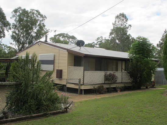 Fully Fenced Acreage with Comfortable Cottage  $395,000 Neg (under offer)